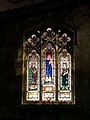 St Edmunds Church, Church Street, Mansfield Woodhouse - Detail of stained glass windows to the Church Street End at dusk 03.jpg