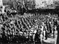 StateLibQld 1 117172 Crowds line the street to watch soldiers on parade in Queen Street Brisbane, ca. 1944.jpg