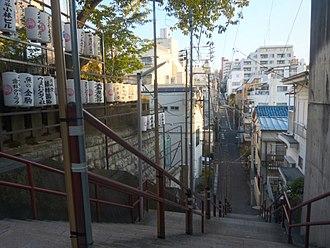 Your Name - Suga-jinja, Shinjuku. The staircase, where Taki and Mitsuha's reunion takes place, has since become a popular photo spot for tourists.