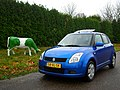 Suzuki Swift + cow (38582096272).jpg
