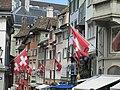 Swiss flags overlooking city.jpg