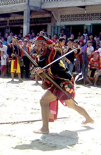 Nias - A man holding a Balato (sword) in a Nias war dance.