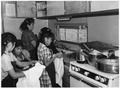 Teacher with students learning sanitary kitchen practices in day school - NARA - 295160.tif