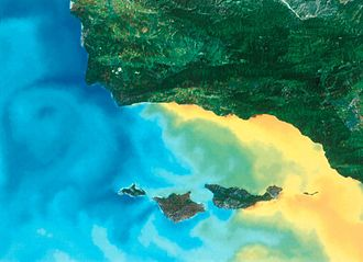 Channel Islands National Marine Sanctuary - This satellite image shows the sea-water temperature variations around the Northern Channel Islands. Temperature ranges are:  blue = 44–52° F, green-yellow = 56–64° F, and orange-red = 65–72° F. From west to east, the islands are: San Miguel, Santa Rosa, Santa Cruz, and Anacapa.