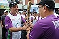 The Chief Minister of Mizoram, Shri Lal Thanhawla receiving the Queen's Baton from the Sports & Youth affairs Minister, Shri Zodintluanga, in Aizawl on July 29, 2010.jpg