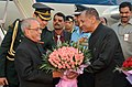 The President, Shri Pranab Mukherjee being received by the Governor of Andhra Pradesh and Telangana, Shri E.S.L. Narasimhan, on his arrival at Hakimpet Airport, in Hyderabad on December 22, 2016.jpg