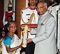 The President, Shri Ram Nath Kovind presenting the Padma Shri Award to Smt. Lekshmikutty, at the Civil Investiture Ceremony, at Rashtrapati Bhavan, in New Delhi on March 20, 2018.jpg