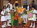 The Prime Minister, Dr. Manmohan Singh and his wife, Smt. Gursharan Kaur with the children who tied Rakhi to him during the occasion of 'Raksha Bandhan', in New Delhi on August 05, 2009.jpg
