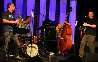 2008 in jazz - Norwegian/Swedish free jazz trio The Thing plays with Ken Vandermark at Kongsberg Jazzfestival, Norway 2008. From the left is Mats Gustafsson (Sweden), Paal Nilssen-Love (Norway), Ingebrigt Håker Flaten (Norway), and Ken Vandermark (Sweden).