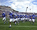 The U.S. Air Force Academy Falcons charge the field prior to their home opener against the Idaho State Bengals at Falcon Stadium in Colorado Springs, Colo., Sept 120901-F-JM997-617.jpg