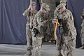 The commander and the command sergeant major of the U.S. Army's 3rd Brigade Combat Team (BCT), 101st Airborne Division case the colors at Forward Operating Base Salerno in Khost province, Afghanistan, May 22 130522-A-CW939-039.jpg