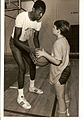 Thurl Bailey and Matt Henrich play one on one.jpg