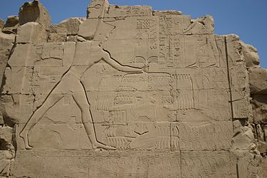 Thutmose III smiting his enemies. Relief on the seventh pylon in Karnak. Thutmose III at Karnak.jpg