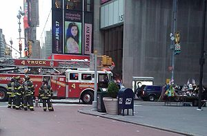 2010 Times Square car bombing attempt - The dark blue Nissan Pathfinder SUV (right) in Times Square, 27 minutes after the attempted attack.  The vehicle's rear hazard lights are on.