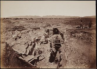 "Ed Schieffelin - The ""Old South Shaft Ore Quarry, Face of Tough-nut Mine, part of Town of Tombstone, Arizona. Dragoon Mountains, with Cochise Stronghold in background,"" mammoth plate, by the American photographer Carleton E. Watkins, 1880"