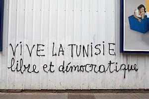 "African French - French-language graffiti on Avenue Habib Bourguiba in Tunis, in March 2012. The graffiti says: ""LONG LIVE TUNISIA (Vive la Tunisie), free and democratic""."