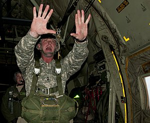 "United States Army Jumpmaster School - A jumpmaster starts the PWAC sequence by gives his paratroopers the ""ten-minutes"" till jump command as he begins to prepare them to exit the aircraft"