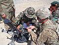 "U.S. Army Sgt. Eric Chaffins, a mortarman assigned to Delta Company, 2nd Battalion, 14th Infantry Regiment, explains the use of a ""whiz"" wheel in conjunction with the mortar site of an M224 60 mm mortar system 130613-A-ZZ999-004.jpg"