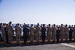 U.S. Marines and Sailors assigned to the 26th Marine Expeditionary Unit (MEU), and Sailors assigned to the USS Kearsarge (LHD 3), hold the American flag to commemorate the Fourth of July during their 2013 130704-M-BS001-005.jpg