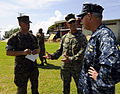 U.S. Navy Capt. Michael Jacobsen, right, the U.S. Naval Forces Southern Command chief of staff, U.S. 4th Fleet, talks with Marine Capt. Etan Anthony, center, and Gunnery Sgt. Chad Fordyce during a Marine Corps 100825-N-EP471-357.jpg