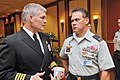 U.S. Navy Capt. Robert Gusentine speaks to chief warrant officer Lincoln Glenister.jpg