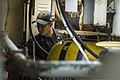 U.S. Navy Gas Turbine Systems Technician (Mechanical) 3rd Class Jennifer Nguyen, left, and Gas Turbine Systems Technician (Mechanical) 3rd Class Todd Lee monitor one of the ship's engineering spaces aboard 131207-N-PJ969-062.jpg
