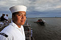 U.S. Navy Hospital Corpsman 1st Class Johnathan Pangan mans the rails aboard the patrol coastal ship USS Hurricane (PC 3) as the ship arrives in Milwaukee, Wis., Aug. 9, 2012, as part of Milwaukee Navy Week 120809-N-YZ751-008.jpg