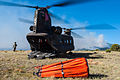 U.S. Soldiers assigned to the 2nd Battalion, 135th Aviation Regiment, Colorado Army National Guard prepare an Army CH-47 Chinook helicopter with the battalion for takeoff to help fight the East Peak wildfire 130621-Z-UA373-019.jpg