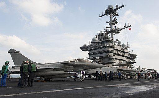 U.S. and French sailors refuel two French navy F1 Rafale aircraft assigned to the aircraft carrier Charles de Gaulle aboard the aircraft carrier USS Harry S. Truman (CVN 75) during carrier qualification 140113-N-XL102-125
