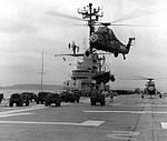 UH-34D lifts vehicle from USS Valley Forge (LPH-8) c1965.jpg