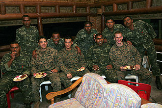 Maldives National Defence Force - Maldive's soldiers of the 20th Special Task Force, share food, and music with U.S. marines and sailors with Combat Logistics Battalion 11 and Battalion Landing Team 1st Battalion
