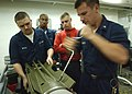 US Navy 020807-N-2147L-002 Sailors aboard CVN 73 dismantal a MK-82 bomb in one of the ship's magazines.jpg