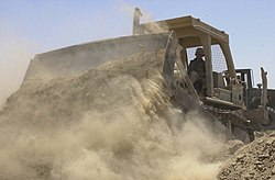 US Navy 030612-N-2517J-001 An Equipment Operator assigned to Naval Mobile Construction Battalion One Three Three (NMCB-133) works to build a protective barrier.jpg