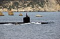 US Navy 040311-N-0780F-027 The nuclear powered attack submarine USS Albany (SSN 753) is escorted out of the Souda Bay harbor by a security patrol boat as she gets underway following a brief port visit.jpg