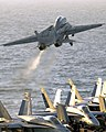 US Navy 040322-N-5319A-003 An F-14B Tomcat assigned to the Red Rippers of Fighter Squadron One One (VF-11) launches off the flight deck of USS George Washington (CVN 73) during evening flight operations.jpg