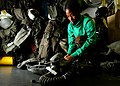 US Navy 041220-N-5345W-031 Aircrew Survival Equipmentman 2nd Class Katrina Sanford performs a routine safety check on the squadron's flight gear inside the Aircrew Survival workcenter.jpg