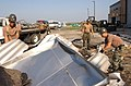 US Navy 050906-N-7405P-006 U.S. Navy Seabees, assigned to Naval Mobile Construction Battalion Four Zero (NMCB-40), remove debris from the flightline-area on board Naval Air Station New Orleans.jpg