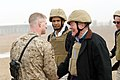 US Navy 060108-M-4314O-002 Missouri Senator Christopher Bond, shakes the hand of his son, II Marine Expeditionary Force S2 Targeting and Collections Officer, 1st Lt. Samuel R. Bond, who came up to the landing zone to welcome hi.jpg