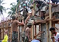 US Navy 060222-N-2527S-018 Seabees assigned to the Naval Mobile Construction Battalion Four (NMCB-4) assist Philippine Army Engineers to construct a bonding beam during a reconstruction project at the Tiptipon School house on S.jpg