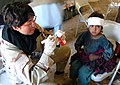 US Navy 060421-M-9565H-002 U.S. Navy Cmdr. Sandra Hearn assigned to the cooperative medical assistance team for Combined Joint Task Force Seven Six (CJTF-76), treats an Afghan girl with a head injury.jpg