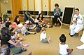 US Navy 060524-N-5324B-003 Aviation 2nd Class Charlene Joiner from Navy Recruiting District (NRD) Nashville sings songs to Children in the Youth Services Department of the Arkansas Main Library.jpg
