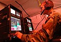 US Navy 060606-N-7987M-028 Operations Specialist 3rd Class David Bently operates a graphical data fusion system (GDFS) for the tactical operations center during exercise DELMAR at Fort Story.jpg