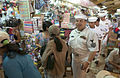 US Navy 060702-N-9851B-005 Sailors assigned to the rescue and salvage ship USS Salvor (ARS 52), walk through the Binh Tay Market.jpg