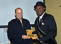 US Navy 070118-N-0857S-007 Commanding Officer Capt. Scott Beyer, Naval Support Activity (NSA) New Orleans, presents a memento from the NSA to Larry Hammond, 2007 King of the Zulu Social Aid and Pleasure Club.jpg