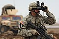 US Navy 070222-N-8148A-287 Pfc. Jason Dore, a forward observer assigned to 2nd Battalion, 5th Cavalry Regiment, 1st Cavalry Division, searches for contacts to safeguard a team.jpg