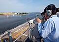 US Navy 070611-N-6282K-010 Quartermaster 3rd Class Ruth Gomez looks through the telescopic alidade as amphibious assault ship USS Iwo Jima (LHD 7) transits the Elizabeth River.jpg