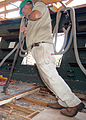 US Navy 080717-N-1060K-001 A shipbuilder from Naval Historical Center Detachment Boston pries planks off the topdeck of USS Constitution.jpg