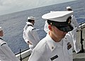 US Navy 080921-N-1745W-098 Members of an honor guard aboard the aircraft carrier USS Abraham Lincoln (CVN 72) bow their heads in prayer during a burial at sea for nine former service members.jpg