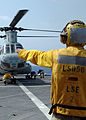US Navy 080925-N-9134V-069 Boatswain's Mate 2nd Class Cody Rufener directs flight crew members.jpg