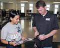US Navy 081007-N-8848T-889 Dale Earnhardt Jr. autographs a hat for Seaman Recruit Heather Martinez.jpg